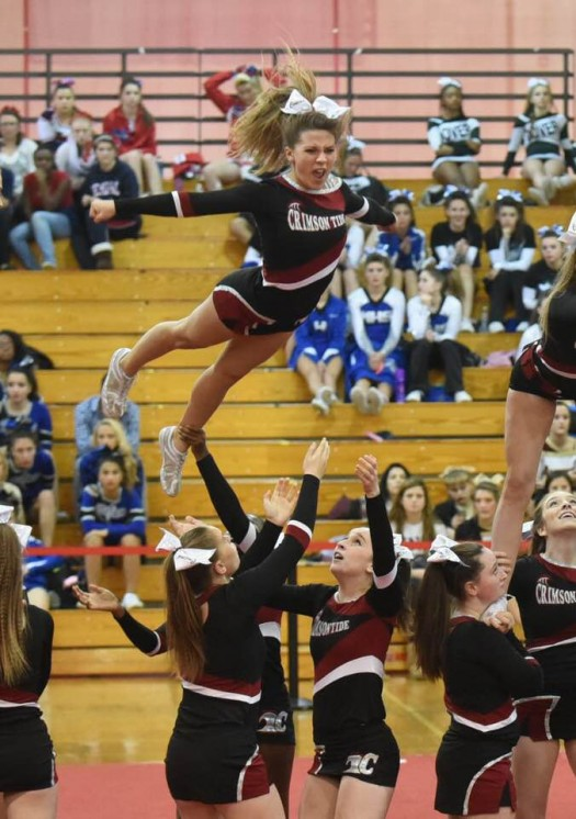 "Courtney Reyes dismounts a stunt in a ""superman"" position"