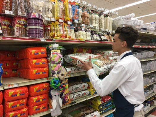 Nour Salif stocks shelves to make shopping easy for others