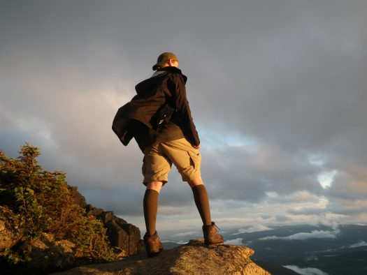 Scout Jacob Bair faces the wind on Mt. Liberty last July