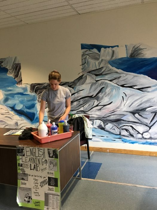 CHS junior Brenna McNamara paints melting Greenland Glacier mural
