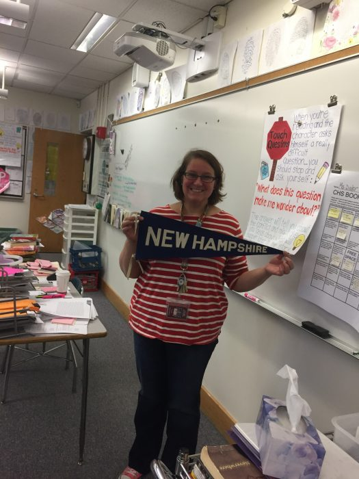 UNH alumna Jill Dater shows off her New Hampshire pride in her 9th grade classroom