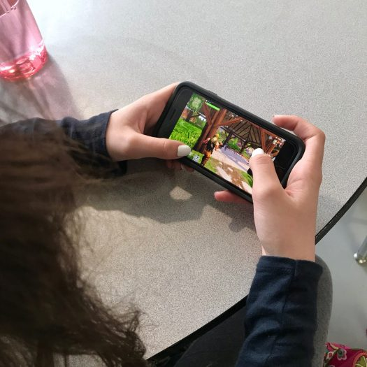 Hannah Willette, freshman, plays Fortnite mobile during her lunch period