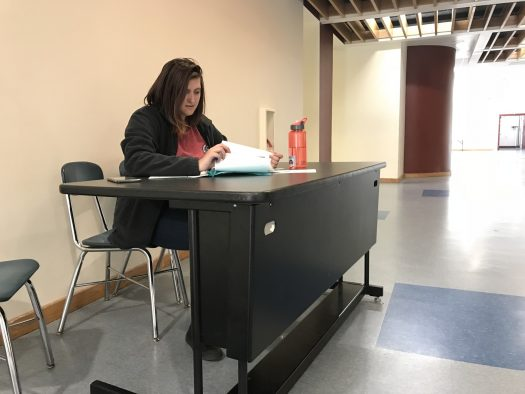 Mackenzie Baum, a senior, studies at the Science Learning Lab table