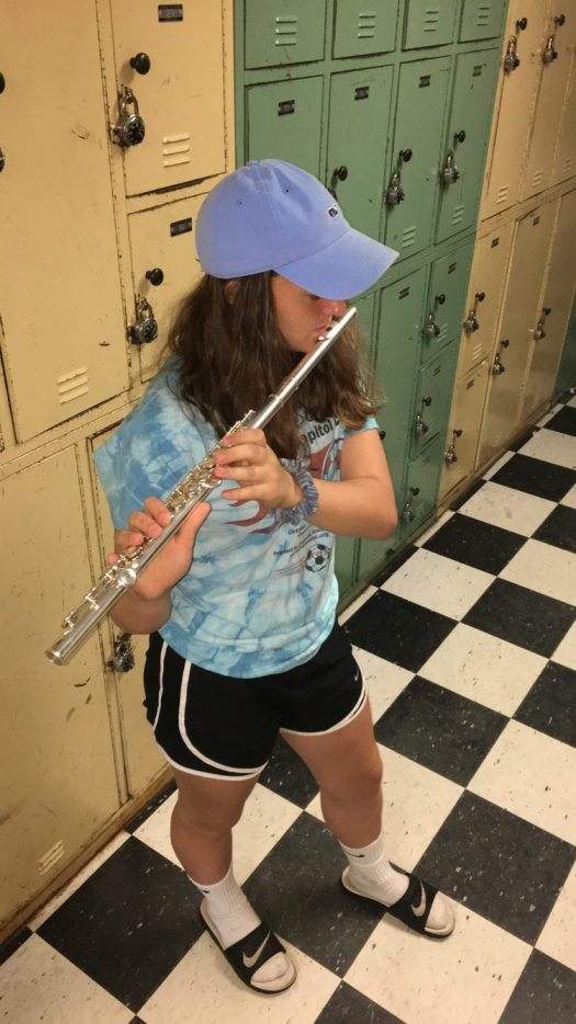 Lexi Adams practices for her last concert June 6