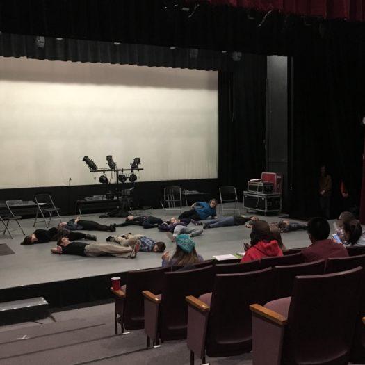 Cast members rehearsing