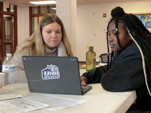 Lily O'Connor, Colby Sawyer volunteer, works with CHS senior Landrine Tumaini