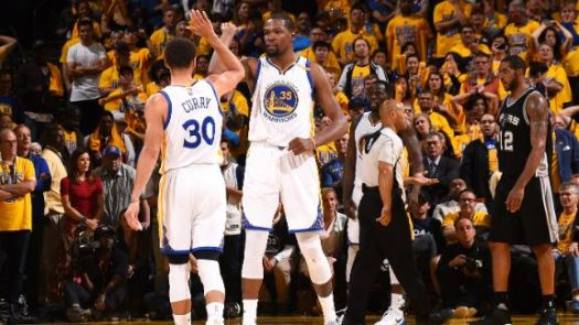 Curry and Durant celebrate 25-point comeback victory.