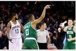Celtics teammates surround Bradley as he sinks last seconds bucket.