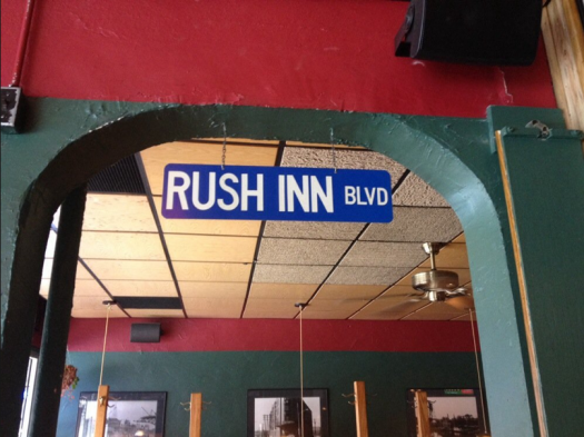 "The ""Rush Inn Blvd"" sign hangs above the entrance to the dining room."