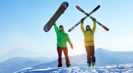 Skier and snowboarder pose for a photo