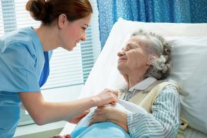 Hospice nurse tending to a patient