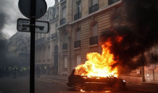 One of nearly 50 cars set on fire in protests