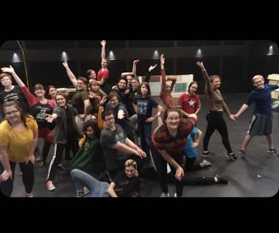 The Mamma Mia cast posing for a picture after their rehearsal.