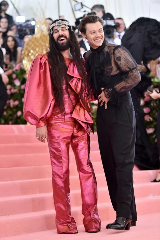 Met Gala co-chairs Alessandro Michele and Harry Styles pose on the pink carpet.