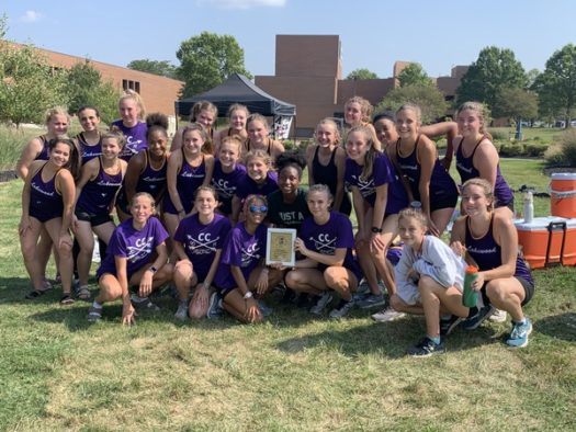 The girls cross country team pose with their first place trophy at the Valley Forge Invitational.