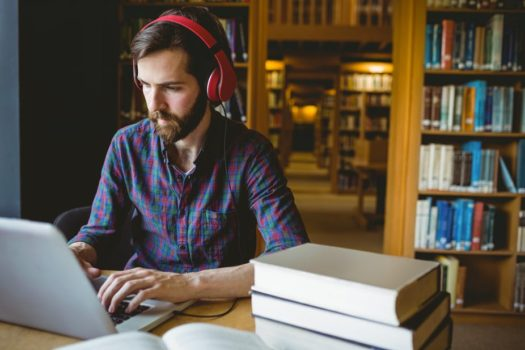 Bearded Man listening to music while working