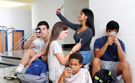 Perfect example of how even though all are together, phones prevent real world interaction.