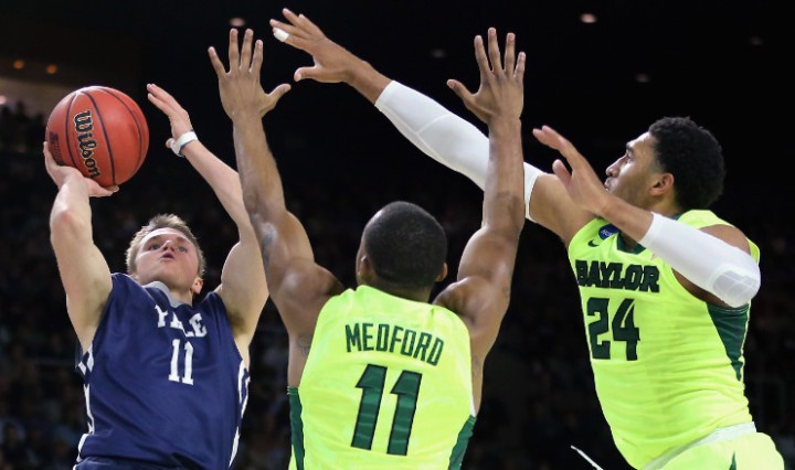 Yale's Makai Mason (11) shoots over Baylor's Lester Medford (11) and Ishmail Wainright (24) in the first half of their game.