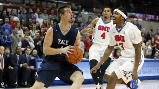 Yale's Jack Montague (4) moves to the basket as SMU guard Sterling Brown (3) defends