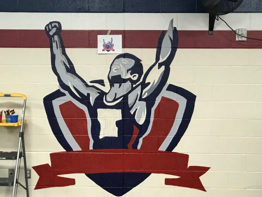The wrestling wall comes to life as NAHS continues to paint the wrestler on the white bricks.