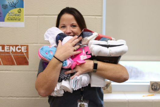 Amanda Sandlin shows off the socks that have been collected.