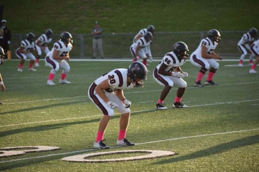 Tompkins football players wear pink socks in support of Breast Cancer awareness month.