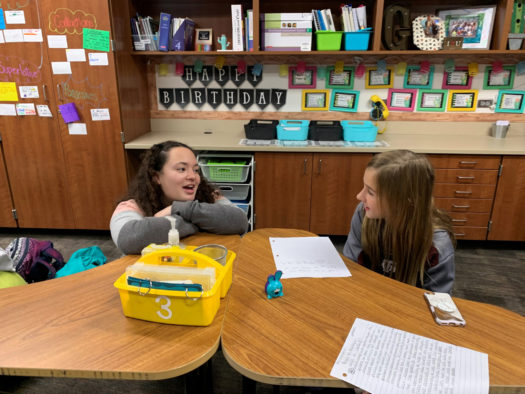 Caroline Hoffmann helps a student with an article