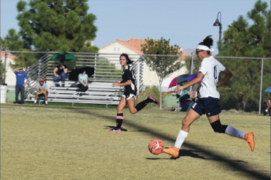 """Varisty soccer player  MacKenzie Carcelli plays a game against Clark HS."""