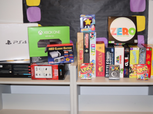 """The gaming club constantly aims to update its collection of consoles and games for members."""