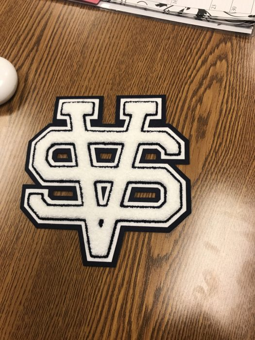 The white varsity letter symbolizes a student's four year commitment to a varsity team.