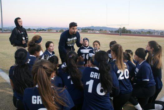 JV flag football coach Nathan Pangelinan talks to his players during half time.