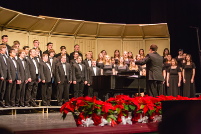 Concert Choir sings in the Christmas Concert under the direction of conductor Spencer Rockford.