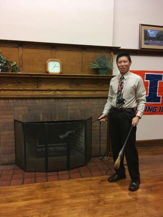Dan Le poses in his new office with his new fireplace tools.