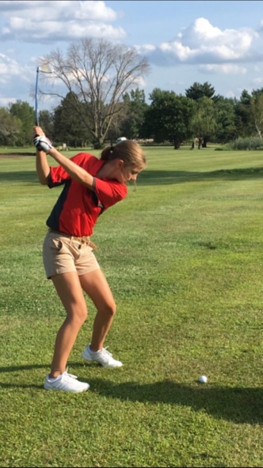 Freshman Megan Bessett competes at a golf meet early this season.