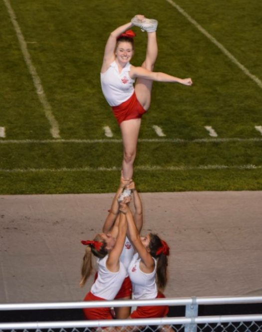 Senior Maddie Lowery flies during a home football game.