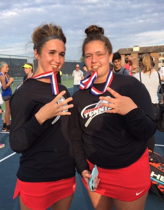 McGraw and Gallagher pose with their medals.