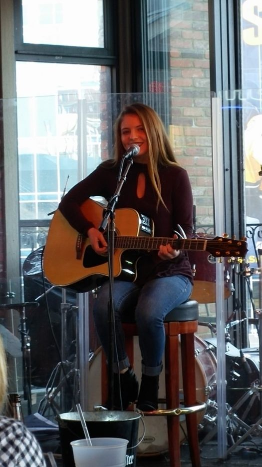 Baudino sings and plays the guitar at one of her gigs in Nashville.