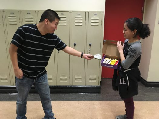 Williams buys a candy bar from Briones to support FAC.