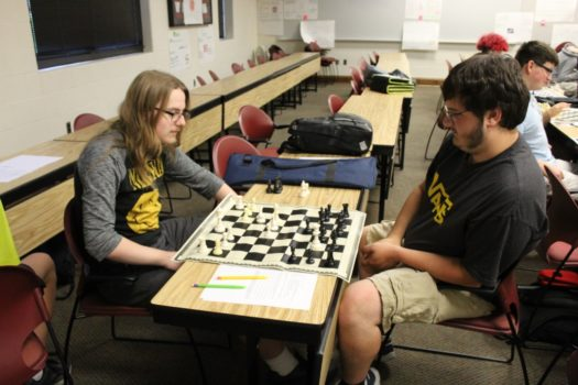 Seniors Kelby Swanson and Andrew Shreve play a match after school.