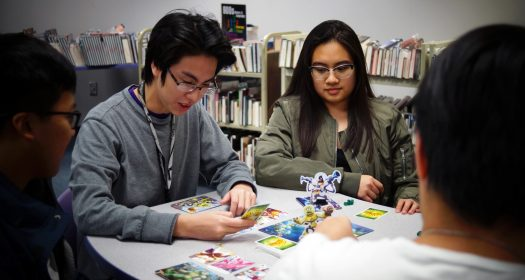Seniors Nam Dang and Liezl Faith Canlas enjoy a game of King of Tokyo with their friends.