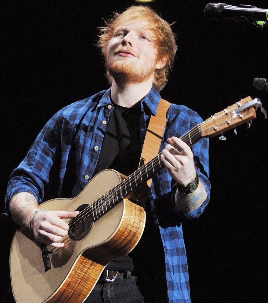 """Music artist Ed Sheeran plays """"Shape of You"""" at a live concert in New York. Photo Credit: James McCarthy"""