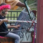 This kid is ready to commonsense in this jousting ride against his opponent