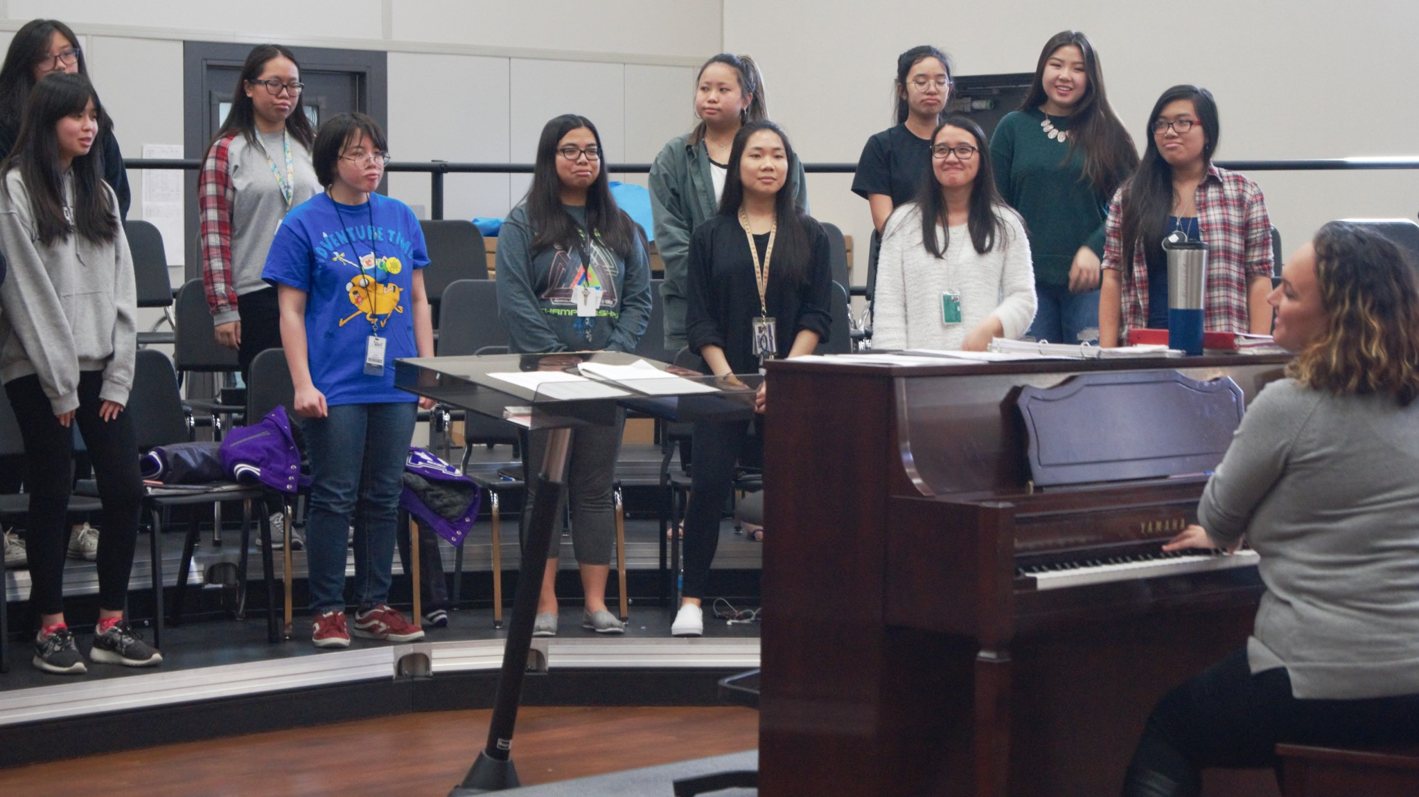 Ms. Winslow is working with her students to practice for their UIL songs Hello Girls by Pfaustch, Tota Pulchra Es by Durufle, and The Lake Isle of Innisfree by Daley.