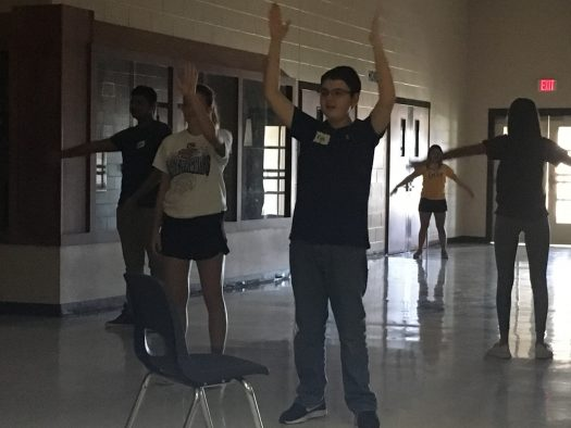 Freshman Kyle Hurst and theatre students work on a mirror task at a theatre workshop.
