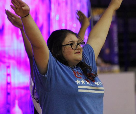 Freshman Callie Harter dances at a pep rally.