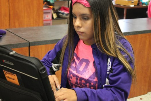 Alex Guevara works on her Chromebook during class.