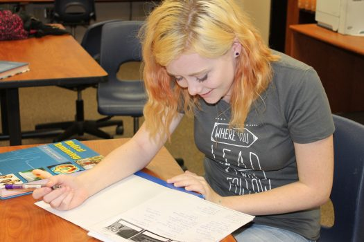 Aniah Anderson works on an assignment during class.