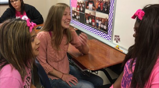 Sarah Slay laughs with classmates before the bell rings.