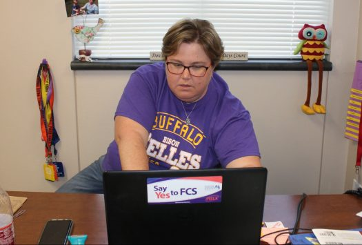 Teacher Melissa Isaacs works on her computer during power hour.