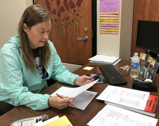 Algebra teacher Debra White grades papers during her conference period.